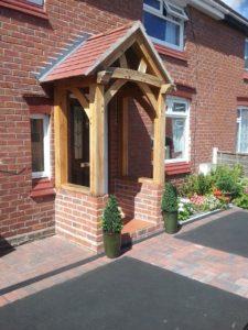 High Brick Plinth Porch Black Door Alt