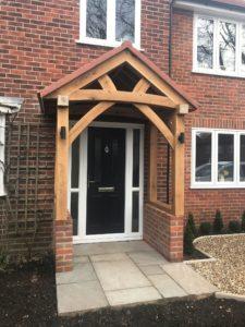 High Brick Plinth Porch Black Door