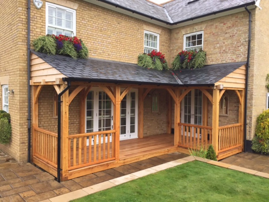 An oak lean-to enclosed porch on a brick house