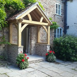 High Brick Plinth Porch Stone with Curved Truss