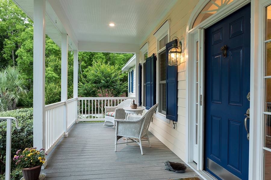 Beautiful front entrance of Southern home with open porch.
